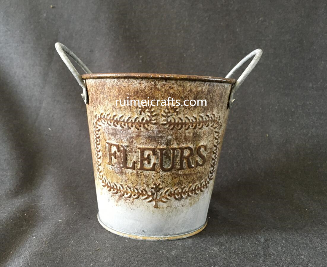 rustic metallic pail for storage or garden