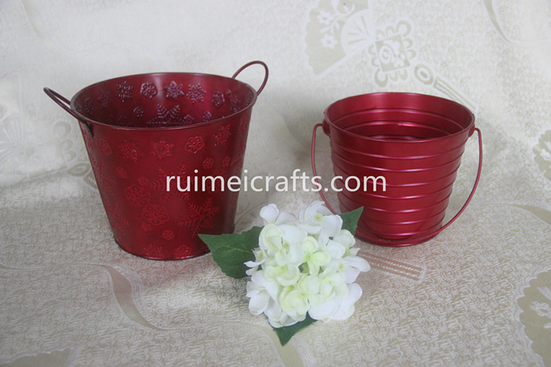 Christmas red metal buckets
