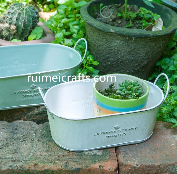 oval metal garden pot with ears