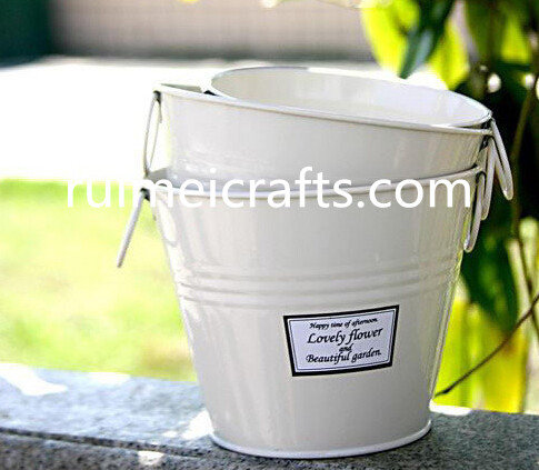 white painted metal garden planter