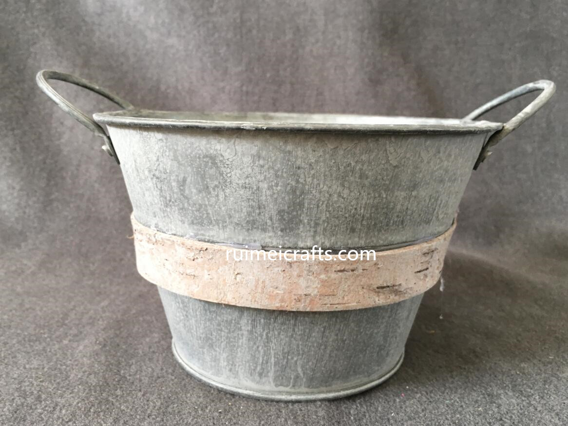 vintage metal bucket with ears and wooden decoration