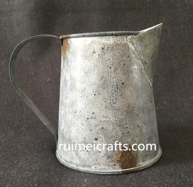 rusty looks like vintage iron sheet watering can