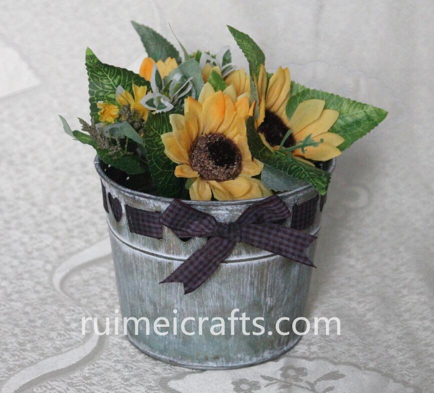 powder coated antique metal planter with ribbon