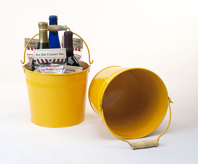 yellow metal pail with handle