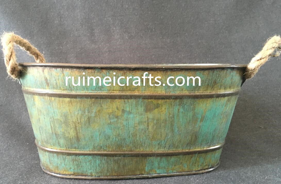 large vintage oval iron sheet pot with sisal ears